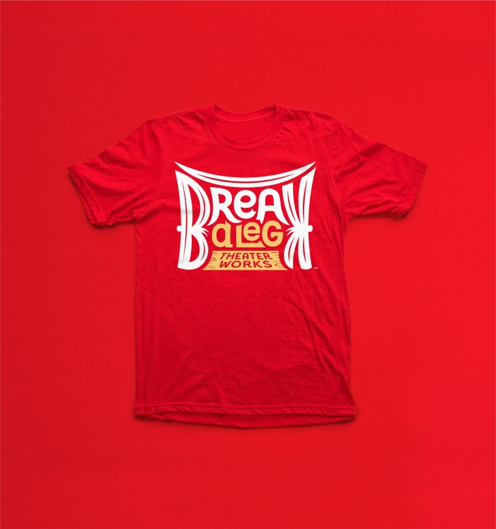 Break A Leg Theater logo on t-shirt with red background
