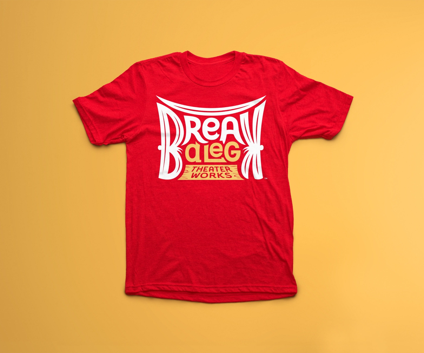 Break A Leg Theater logo on t-shirt with yellow background