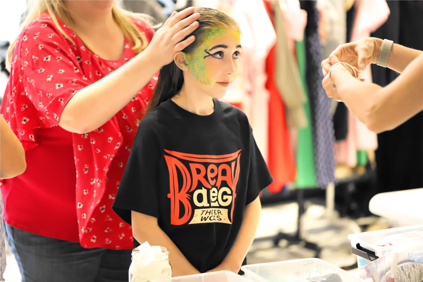 Theater t-shirt on girl getting hair and makeup