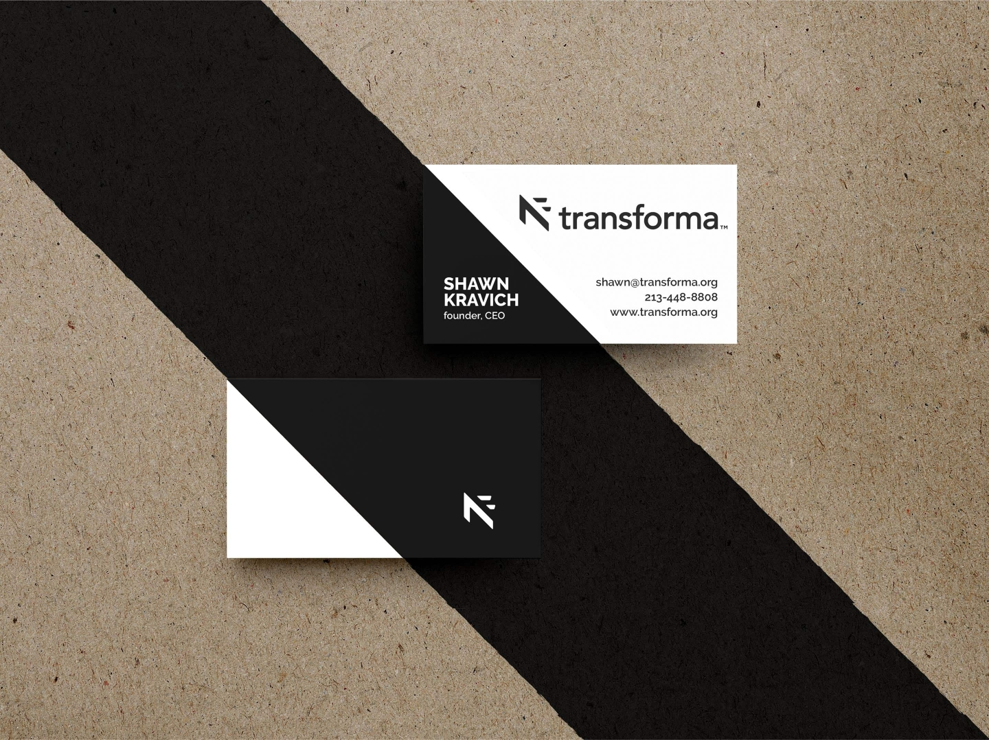 Transforma business cards on craft paper with stripe