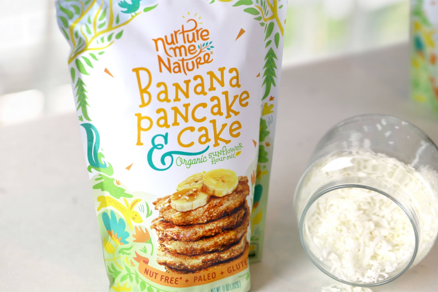 Nurture Me Nature packaging Banana Pancake flavor in kitchen setting