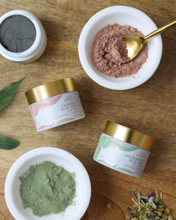 Natural clay masks on wood table with ingredients